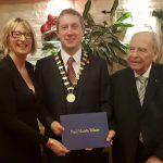 Presidentof Wexford Rotary receiving his Paul Harris Felloship form Jurgen Sassmanhausen and Vice President Maura Bell